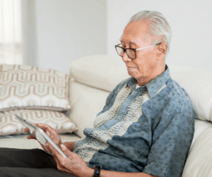Elderly Gentleman using a tablet