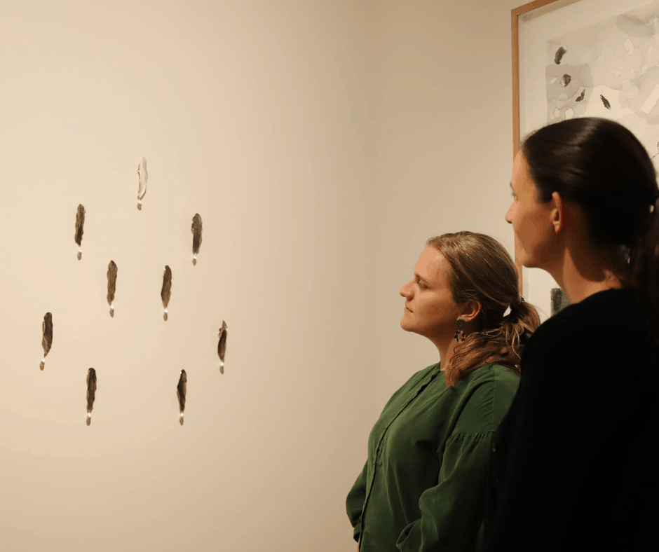 Eve Williams Curator Devonport Regional Gallery and Ellina Evans Creative learning and Public Programs Officer admiring the winning work Kelp Elegy by Hobart based artist Janine Combes.