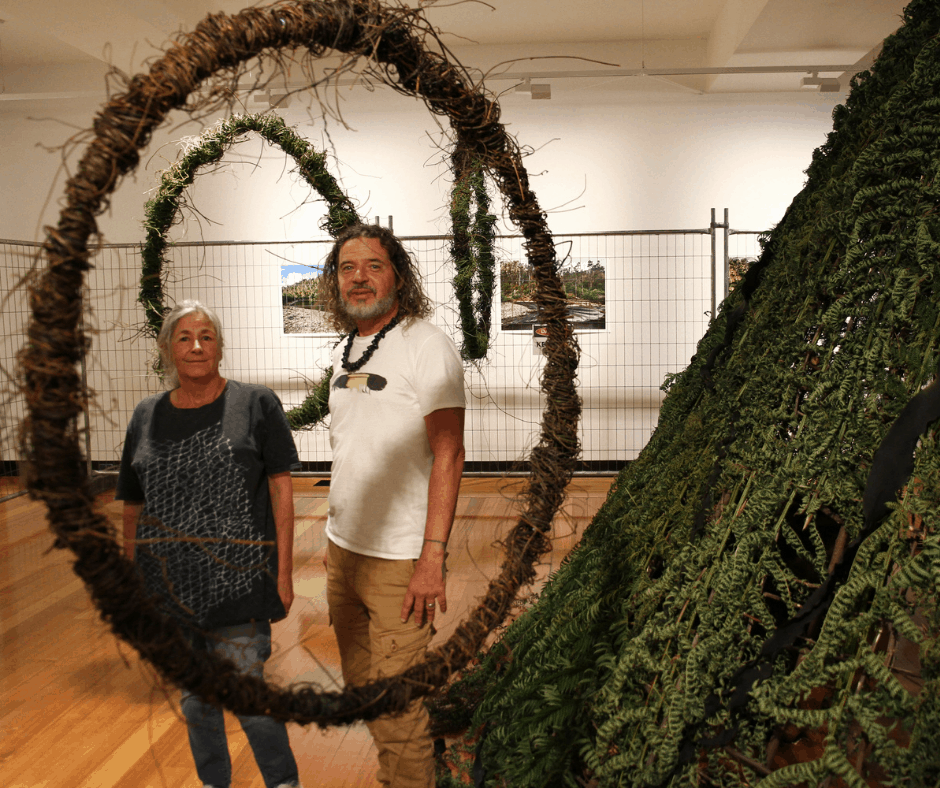 Aboriginal artists Dave mangenner Gough and Vicki West near the dome hut and hoops, which form part of their art installation Constrained – Reclaimed.