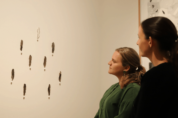Eve Williams, Curator Devonport Regional Gallery And Ellina Evans, Creative Learning And Public Programs Officer Admiring The Winning Work Kelp Elegy, By Hobart Based Artist Janine Combes.